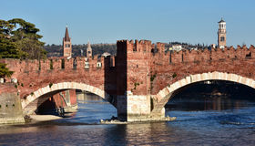Scaliger Bridge in Verona with city tallest tower and belfries Royalty Free Stock Photos