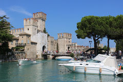 Scaliger Castle and boats, Sirmione, Italy Stock Photos