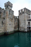 Scaliger Castle, Sirmione, Lake Garda, Italy. Scaliger Castle (Castello Scaligero/Rocca Scaligera) is an ancient medieval fortification-port that guard the stock photography