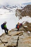 Scaling 4107m high mountain Moench, Switzerland Stock Image