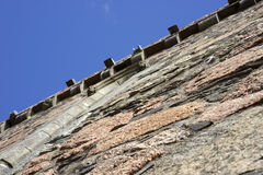 Scaling the castle or medieval insurance? Royalty Free Stock Photography