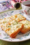 Scallion cookie nougats. With tea on the plate royalty free stock photography