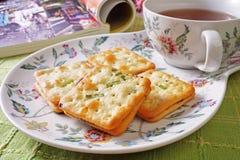Scallion cookie nougats. With tea on the plate stock photos