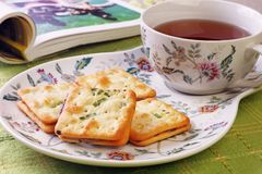 Scallion cookie nougats. With tea on the plate royalty free stock photo