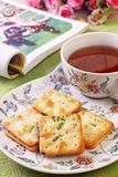 Scallion cookie nougats. With tea on the plate stock images