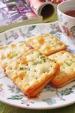 Scallion cookie nougats. With tea on the plate stock image