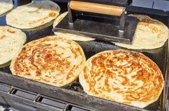 Scallion Pancakes. Asian scallion pancakes cooking on a grill Stock Photos
