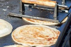 Scallion Pancakes. Asian scallion pancakes cooking on a grill Royalty Free Stock Photography