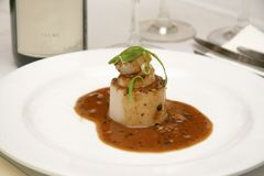 Scallop. In brown mushroom sauce topped with freshly cooked scallions stock photos