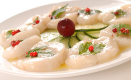 Scallop carpaccio with parsley Royalty Free Stock Photos