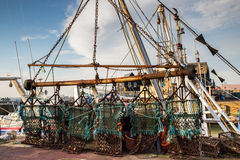 Scallop dredge hanging in a harbour Stock Photography