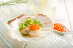 Scallop with eggs salmon Stock Photo