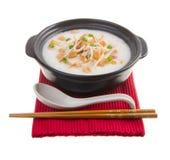 Scallop porridge rice gruel served in claypo Royalty Free Stock Photos