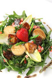 Scallop salad with strawberry and lettuce herbs on white plate. Deliciously Royalty Free Stock Photo
