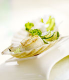 Scallop served in a scallop shell. Scallops served in a scallop shell with zucchini Stock Photo