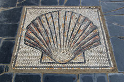 Scallop shell symbol in the ground saint james way Royalty Free Stock Photos