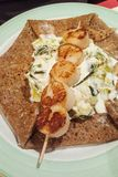 Scallop shellfish meat on skewer crepe with French pancake. Crepe stock photos