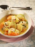 Scallop soup with citrus fruit and coriander Stock Photo