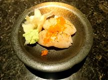 Scallop Sushi. Roasted Scallop Sushi with Wasabi and Ginger royalty free stock photos