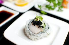 Scallop sushi roll on plate Stock Photos