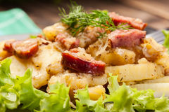 Scalloped potatoes with sausage and bacon Stock Photography