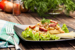 Scalloped potatoes with sausage and bacon Royalty Free Stock Image