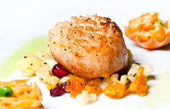 Scallops. With petit poise and apricote stock images