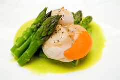 Scallops with asparagus Stock Photo