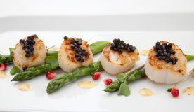 Scallops and Black Caviar Royalty Free Stock Photos