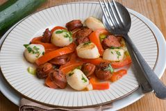 Scallops with chorizo Stock Photography