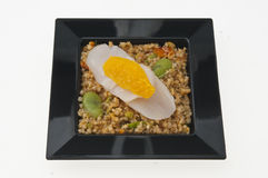 Scallops and Quinoa on black plate. Royalty Free Stock Photos