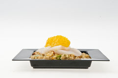 Scallops and Quinoa on black plate. Royalty Free Stock Images
