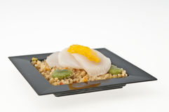 Scallops and Quinoa on black plate. Royalty Free Stock Image