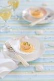 Scallops with saffron sauce. On seashell stock photos