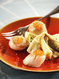 Scallops with salmon roe Stock Image