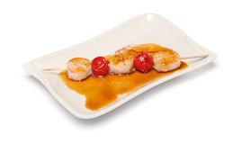 Scallops on a skewer with tomatoes Stock Images