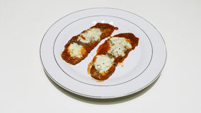 Scallops with tomato. Meat with Pizzaiola Sauce and cheese Royalty Free Stock Images