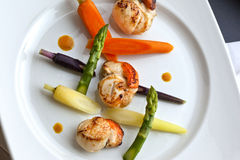 Scallops and vegetables Stock Photo