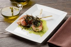 Scallops with wooden skewers stock images