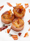 Scallops wrapped in bacon and seared Royalty Free Stock Photography