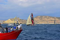 Scallywag Passing Spectator Boats Volvo Ocean Race Alicante 2017. Squeezing between spectator boats in Alicante bay on the first leg of the round the World race Royalty Free Stock Photo