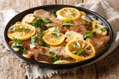 Free Scaloppini Tender Veal Cooked With Mushrooms And Lemons In A Spicy Sauce Close-up In A Frying Pan On The Table. Horizontal Stock Photos - 134595283