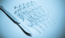 Scalpel and ampoules Royalty Free Stock Photography