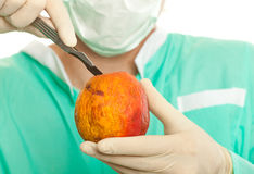 Scalpel and apple Royalty Free Stock Image