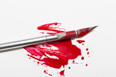 Scalpel blade with blood Royalty Free Stock Images
