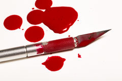 Scalpel blade with blood Stock Photography