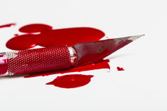 Scalpel blade with blood. Macro picture stock image