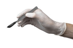 Scalpel in hand in glove on white background, isolated Stock Photography