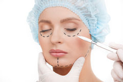 Scalpel near face. Stock Photo