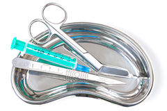Scalpel and Scissors and Syringe. In stailess steel kidney dish royalty free stock photography